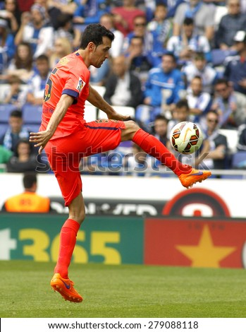BARCELONA - APRIL, 25: Sergio Busquets of FC Barcelona during a Spanish League match against RCD Espanyol at the Power8 stadium on April 25, 2015 in Barcelona, Spain - stock photo