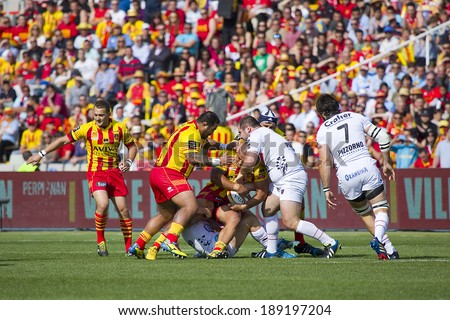 BARCELONA - APRIL 19: Some players in action at rugby Top14 french league match between USAP Perpignan and Toulon (white), final score 31-46, on April 19, 2014, in Barcelona Olympic stadium, Spain.