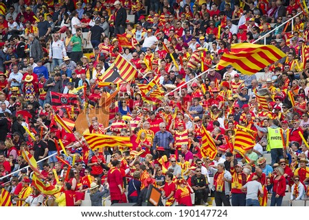 BARCELONA - APRIL 19: Some USAP supporters in action at rugby Top14 french league match between USAP Perpignan and Toulon, final score 31-46, on April 19, 2014, in Barcelona Olympic stadium, Spain. - stock photo