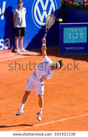 BARCELONA - APRIL 29: Spanish tennis player David Ferrer in action during his final match against Rafael Nadal at Barcelona tennis tournament Conde de Godo on April 29, 2012, in Barcelona, Spain. - stock photo
