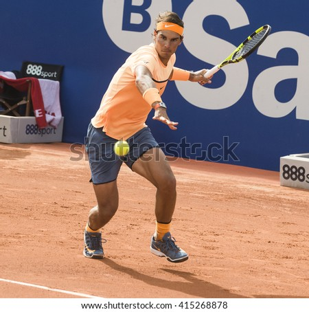 BARCELONA - APRIL 20: Spanish tennis player Rafael Nadal returns a ball during the Barcelona Open Banc Sabadell at Real Club Tenis Barcelona, on April 20, 2016 in Barcelona, Spain.  - stock photo