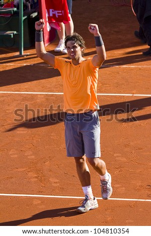 BARCELONA - APRIL 29: Spanish tennis player Rafael Nadal wins the final match against David Ferrer at Barcelona tennis tournament Conde de Godo on April 29, 2012, in Barcelona, Spain. - stock photo