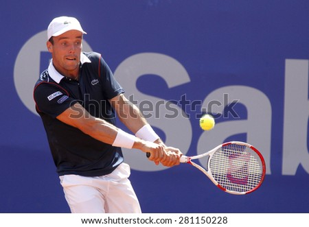 BARCELONA - APRIL, 23: Spanish tennis player Roberto Bautista Agut in action during a match of Barcelona tennis tournament Conde de Godo on April 23, 2015 in Barcelona - stock photo