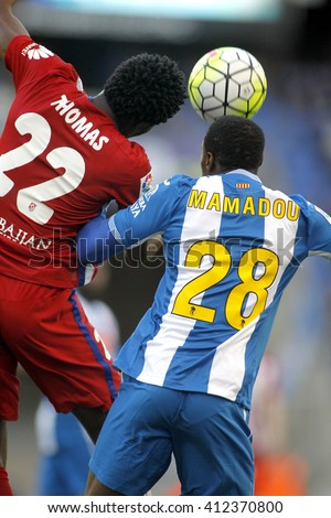 BARCELONA - APRIL, 9: Thomas Partey(L) of Atletico Madrid and Mamadou Sylla(R) of RCD Espanyol vie during a Spanish League match at the Power8 stadium on April 9, 2016 in Barcelona, Spain - stock photo