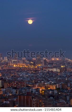 Barcelona at night with full moon, Catalunya, Spain - stock photo
