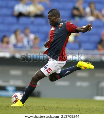 BARCELONA - AUG, 17: Isaac Cofie of Genoa CFC in action during a friendly match against RCD Espanyol at the Estadi Cornella on August 17, 2014 in Barcelona, Spain - stock photo