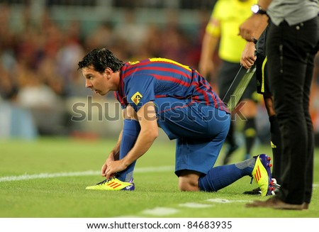 BARCELONA - AUG, 22: Leo Messi of FC Barcelona during Joan Gamper Trophy match between FC Barcelona and SSC Napoli at Nou Camp Stadium in Barcelona, Spain. August 22, 2011 - stock photo
