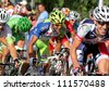 BARCELONA - AUG 26: Liquigas Cannondale Italian cyclist Cristiano Salerno(C) rides with the pack during the Vuelta Ciclista a Espana cycling race in Barcelona on August 26, 2012 - stock photo
