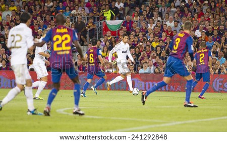 BARCELONA - AUGUST 17: Cristiano Ronaldo of RM in action at the Spanish Super Cup final match between FC Barcelona and Real Madrid, 3 - 2, on August 17, 2011 in Camp Nou stadium, Barcelona, Spain. - stock photo