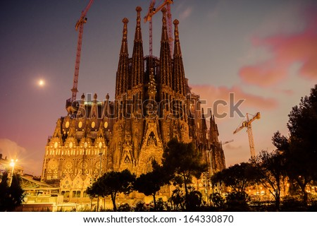 BARCELONA - AUGUST 24: La Sagrada Familia cathedral designed by Antoni Gaudi, which is being build since 1882 and is not finished yet August 24, 2012, in Barcelona, Spain. - stock photo