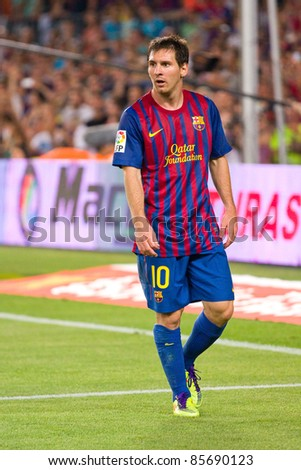 BARCELONA - AUGUST 17: Leo Messi in action during the Spanish Super Cup final match between FC Barcelona and Real Madrid, 3 - 2, on August 17, 2011 in Camp Nou stadium, Barcelona, Spain. - stock photo