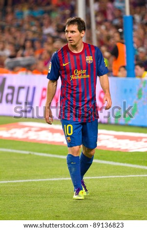 BARCELONA - AUGUST 17: Leo Messi in action during the Spanish Super Cup final match between FC Barcelona and Real Madrid, final score 3 - 2, on August 17, 2011 in Camp Nou stadium, Barcelona, Spain. - stock photo