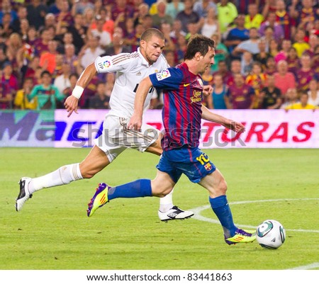 BARCELONA - AUGUST 17: Leo Messi (R) and Pepe Laveran (L) in action during the Spanish Supercup final match between FC Barcelona and Real Madrid, 3 - 2, on August 17, 2011 in Barcelona, Spain.