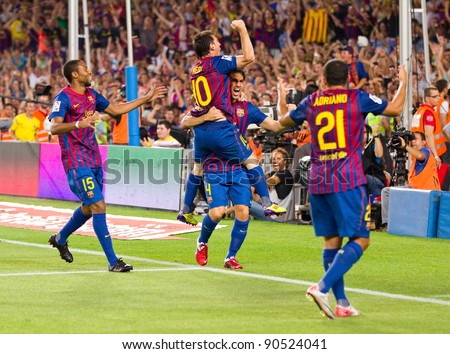 BARCELONA - AUGUST 17: Players celebrates the goal of Leo Messi during the Spanish Super Cup final match between FC Barcelona & Real Madrid, 3 - 2, on August 17, 2011 in Barcelona, Spain. - stock photo