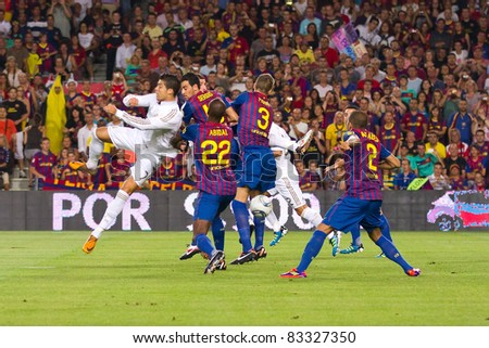 BARCELONA - AUGUST 17: Some players in action during the Spanish Supercup final match between FC Barcelona and Real Madrid, 3 - 2, on August 17, 2011 in Camp Nou stadium, Barcelona, Spain. - stock photo