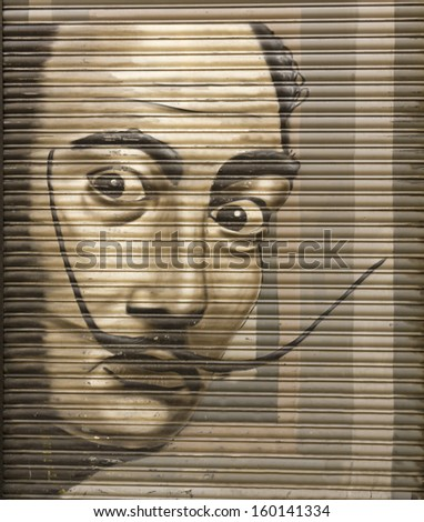 BARCELONA - AUGUST 21: Tribute to Salvador Dali in a metal shutter on Aug 21, 2013 in Gothic Quarter of Barcelona, Spain. The painter is considered one of the greatest representatives of surrealism. - stock photo