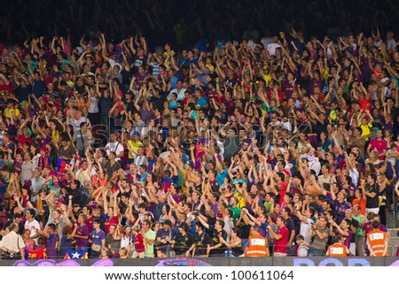 BARCELONA - AUGUST 17: Unidentified people celebrate a goal at the Spanish Super Cup final match between FC Barcelona and Real Madrid, 3 - 2, on August 17, 2011 in Camp Nou stadium, Barcelona, Spain. - stock photo