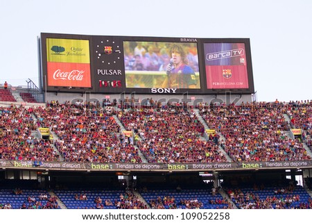BARCELONA - AUGUST 22: Unidentified supporters during the Gamper Trophy final match between FC Barcelona and Napoli, final score 5 - 0, on August 22, 2011 in Camp Nou stadium, Barcelona, Spain. - stock photo