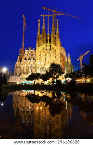 BARCELONA, CATALONIA - JULY 14, 2013:  Basilica and Expiatory Church of Holy Family, building is begun in 1882 and completion is planned in 2030 - stock photo