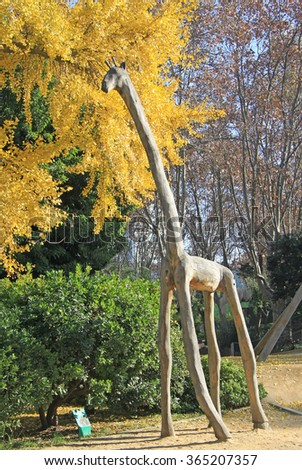 BARCELONA, CATALONIA, SPAIN - DECEMBER 12, 2011: Wooden giraffe in Zoo