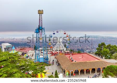 Barcelona city from mountain top Tibidabo. Catalonia, Spain. - stock photo