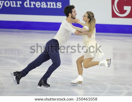 BARCELONA - DEC, 13: Gabriella Papadakis and Guillaume Cizeron from France during Pairs Ice Dance event of ISU Grand Prix of Figure Skating Final 2014 at CCIB on December 13, 2014 in Barcelona, Spain - stock photo