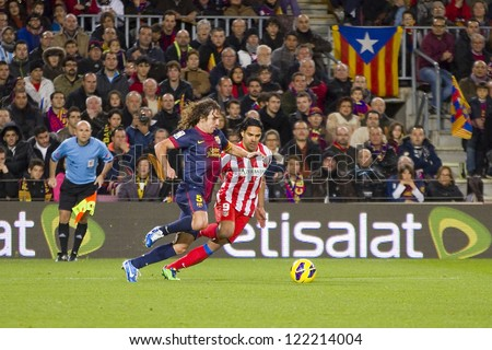 BARCELONA - DECEMBER 16: Carles Puyol (L) and Radamel Falcao at the Spanish League match between FC Barcelona and Atletico de  Madrid, final score 4 - 1, on December 16, 2012, in Barcelona, Spain. - stock photo