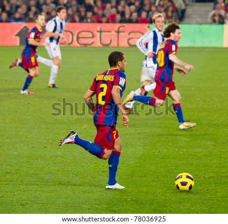 BARCELONA - DECEMBER 13: Dani Alves (2) in action during the Spanish Soccer League match between FC Barcelona and Real Sociedad, 5 - 0, in Camp Nou stadium. December 13, 2010 in Barcelona (Spain).