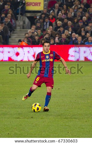 BARCELONA - DECEMBER 13: Nou Camp stadium, FC Barcelona - Real Sociedad, 5 - 0. In the picture, Xavi Hernandez in action. December 13, 2010 in Barcelona (Spain). - stock photo