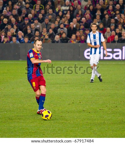BARCELONA - DECEMBER 13: Nou Camp stadium, Spanish Soccer League: FC Barcelona - Real Sociedad, 5 - 0. In the picture, Andres Iniesta (left) in action. December 13, 2010 in Barcelona (Spain). - stock photo