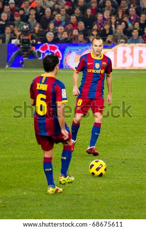 BARCELONA - DECEMBER 13: Nou Camp stadium, Spanish Soccer League match: FC Barcelona - Real Sociedad, 5 - 0. In the picture, Xavi and Iniesta in action. December 13, 2010 in Barcelona (Spain). - stock photo