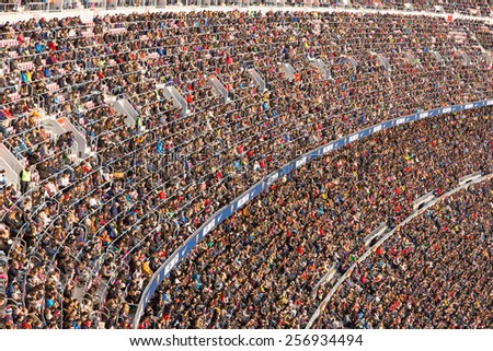 BARCELONA - FEB 21: Audience at the Camp Nou Stadium in the football match between Futbol Club Barcelona and Malaga of the Spanish BBVA League on February 21, 2015 in Barcelona, Spain. - stock photo