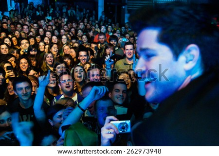BARCELONA - FEB 12: Crowd at The Script (band) performs at Razzmatazz club on February 12, 2011 in Barcelona, Spain. - stock photo