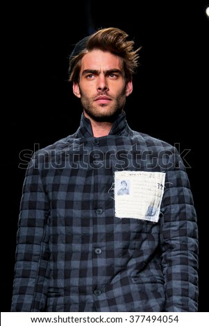 BARCELONA - FEB 3: Jon Kortajarena (model) walks the runway for the Miriam Ponsa collection at the 080 Barcelona Fashion Week 2015 Fall Winter on February 3, 2015 in Barcelona, Spain.