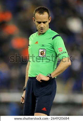 BARCELONA - 8, FEB: Referee Mario Melero Lopez check the time during a Spanish League match between RCD Espanyol vs Valencia CF at the Estadi Cornella on February 8, 2015 in Barcelona, Spain - stock photo