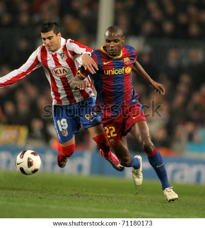 BARCELONA - FEB 5: Reyes(L) of Atletico fight with Abidal(R) of Barcelona during the match between FC Barcelona and Atletico Madrid at the Nou Camp Stadium on February 5, 2011 in Barcelona, Spain - stock photo