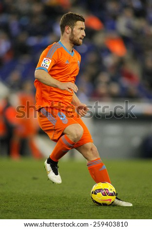 BARCELONA - 8, FEB: Shkodran Mustafi of Valencia CF during spanish League match against RCD Espanyol at the Estadi Cornella on February 8, 2015 in Barcelona, Spain - stock photo