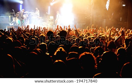 BARCELONA - FEB 15: The crowd at the Kaiser Chiefs (famous British indie rock band) concert at Razzmatazz Clubs on February 15, 2014 in Barcelona, Spain. - stock photo
