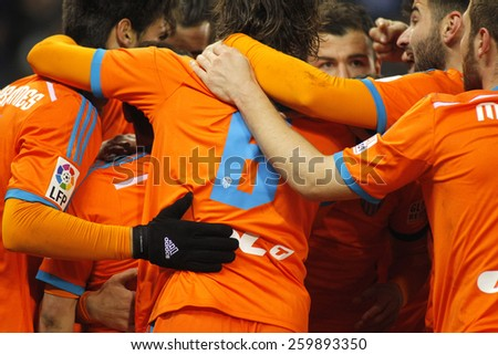 BARCELONA - 8, FEB: Valencia CF players hugging during spanish League match against RCD Espanyol at the Estadi Cornella on February 8, 2015 in Barcelona, Spain - stock photo