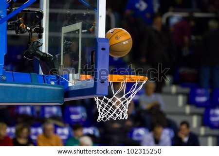 BARCELONA - FEBRUARY 29: Ball inside the basket net during the Euroleague basketball match between FC Barcelona and Maccabi Tel Aviv, final score 70-67, on February 29, 2012, in Barcelona, Spain.