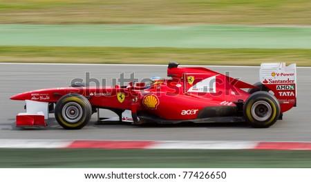 BARCELONA - FEBRUARY 18: Fernando Alonso (Ferrari) drives his F1 car during Formula 1 Teams Test Days at Catalunya circuit on February 18, 2011 in Barcelona, Spain. - stock photo