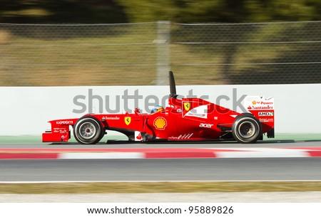 BARCELONA - FEBRUARY 21: Fernando Alonso of Ferrari F1 team races during Formula One Teams Test Days at Catalunya circuit on February 21, 2012 in Barcelona, Spain. - stock photo