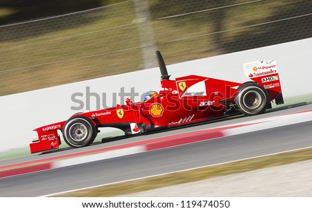 BARCELONA - FEBRUARY 21: Fernando Alonso of Ferrari F1 team racing at Formula One Teams Test Days at Catalunya circuit on February 21, 2012 in Barcelona, Spain. - stock photo