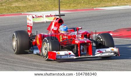 BARCELONA - FEBRUARY 21: Fernando Alonso of Ferrari F1 team racing during Formula One Teams Test Days at Catalunya circuit on February 21, 2012 in Barcelona, Spain - stock photo