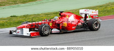 BARCELONA - FEBRUARY 18: Fernando Alonso of Ferrari team drives his F1 car during Formula One Teams Test Days at Catalunya circuit on February 18, 2011 in Barcelona, Spain.