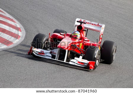 BARCELONA - FEBRUARY 18: Fernando Alonso of Ferrari team driving his F1 car during Formula One Teams Test Days at Catalunya circuit, on February 18, 2011 in Barcelona, Spain.