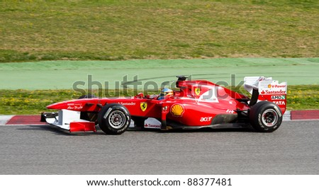 BARCELONA - FEBRUARY 18: Fernando Alonso of Ferrari team driving his F1 car during Formula One Teams Test Days at Catalunya circuit on February 18, 2011 in Barcelona, Spain.