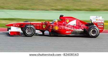 BARCELONA - FEBRUARY 18: Fernando Alonso of Ferrari tests his F1 car during Formula One Teams Test Days at Catalunya circuit, on February 18, 2011 in Barcelona, Spain.