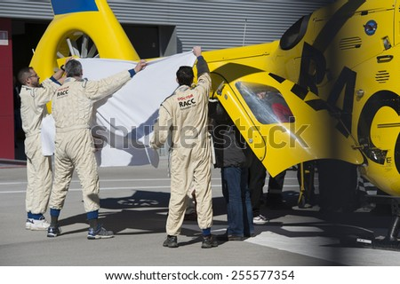 BARCELONA - FEBRUARY 22: Fernando Alonso of Mclaren Honda airlifted to hospital after crash during the last day of Formula One Test Days at Catalunya Circuit on February 22, 2015 in Barcelona, Spain. - stock photo