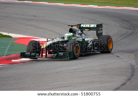 BARCELONA - FEBRUARY 28: Heikki Kovalainen (Lotus) tests his new car during Formula One Teams Test Days at Catalunya circuit February 28, 2010 in Barcelona.